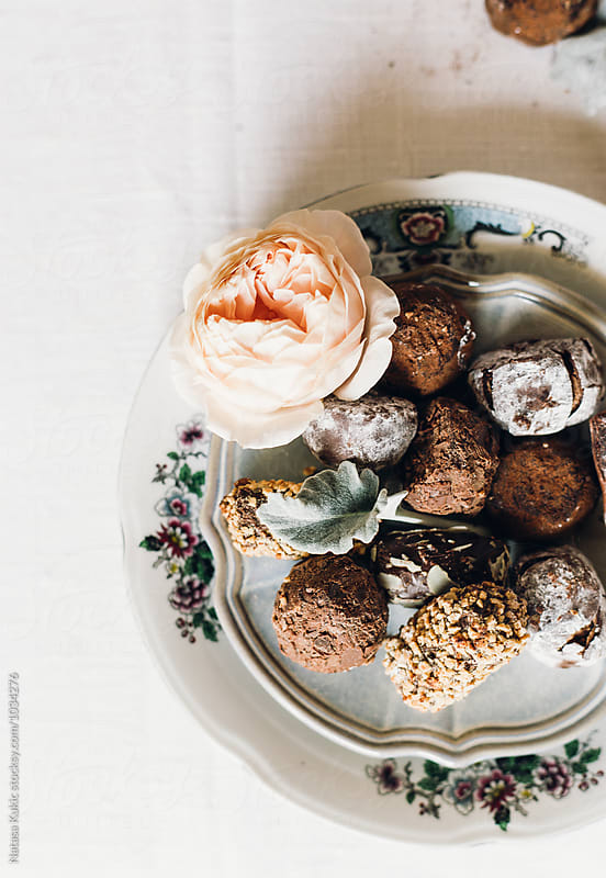 Stylized plate of Belgian chocolate truffles by Natasa Kukic for Stocksy United