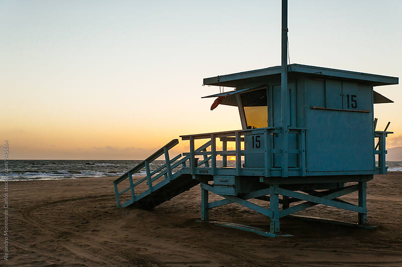 Lifeguard hut at sunset in California by Alejandro Moreno de Carlos for Stocksy United