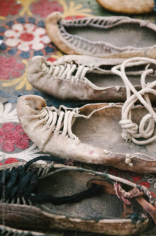 Old leather shoes, Xinaliq. by Thomas Pickard for Stocksy United