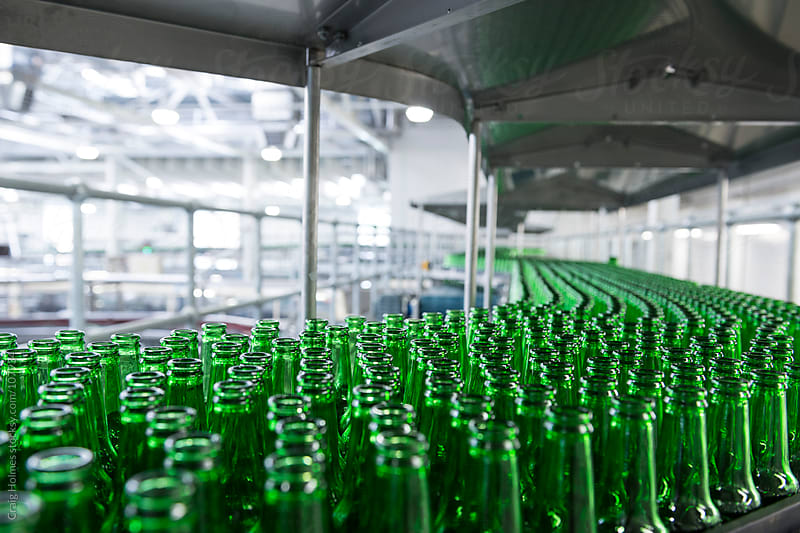 A beer bottling factory by Craig Holmes for Stocksy United