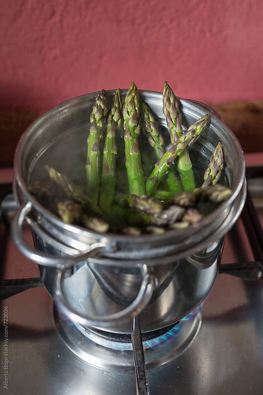 Cooking asparagus by Alberto Bogo for Stocksy United