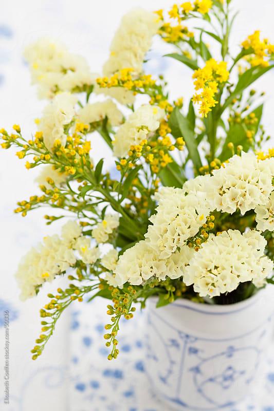 Solidago flower bouquet by Elisabeth Coelfen for Stocksy United