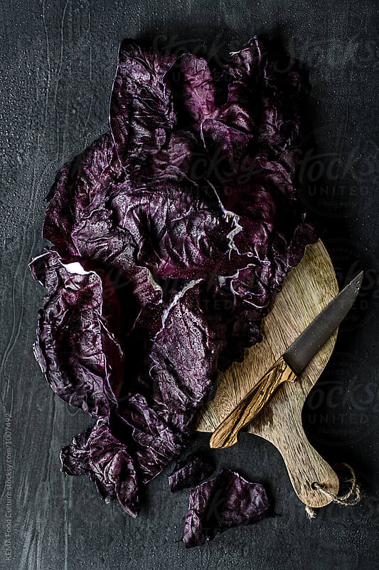 Red cabbage leaves on a wooden cutting board by KEMA Food Culture for Stocksy United