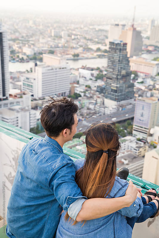Couple in love looking at the city by Jovo Jovanovic for Stocksy United