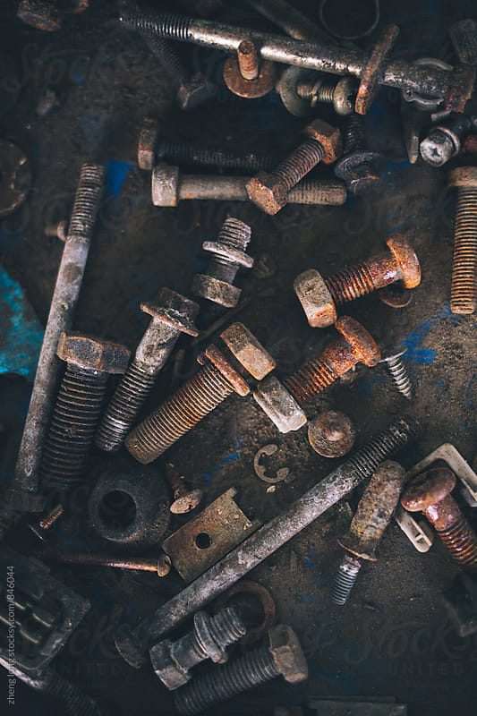 scrap screws in vehicle repair plant by zheng long for Stocksy United