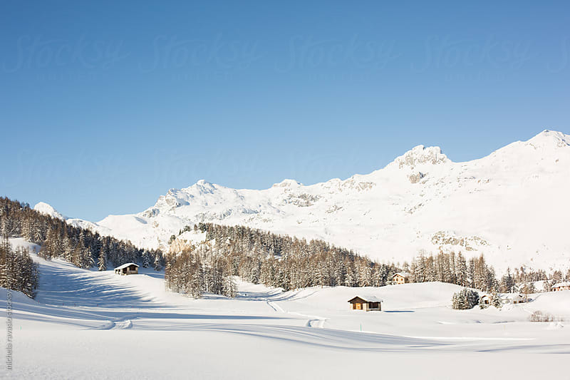 Group of houses in the mountains in a winter landscape by michela ravasio for Stocksy United