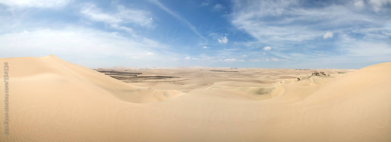 Expansive sand dunes panorama by Ben Ryan for Stocksy United