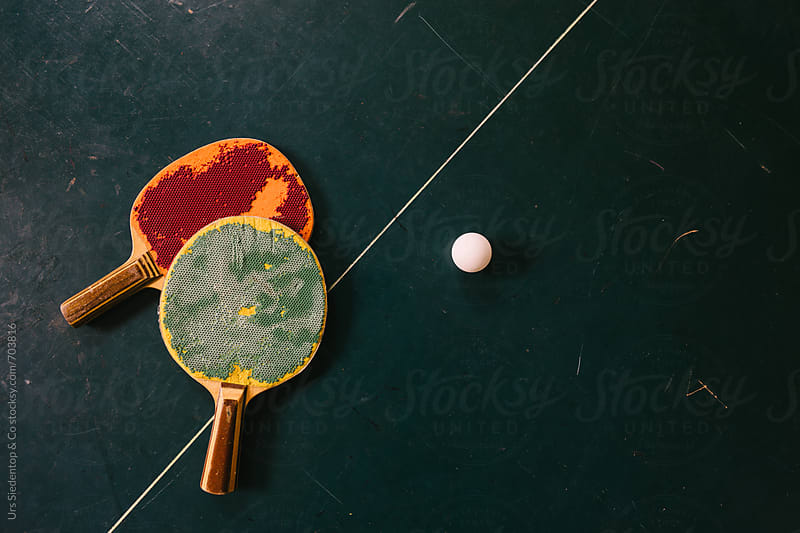 Pair of run down ping pong racketes and ping pong ball from above by Urs Siedentop & Co for Stocksy United