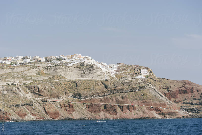 Santorini and the Oia Cliffs, view from a boat by Maa Hoo for Stocksy United