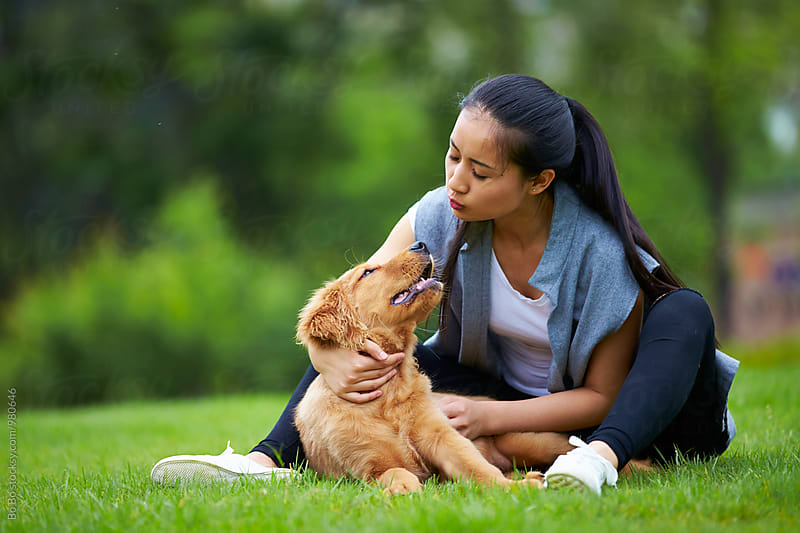 happy young asian woman outdoor with her dog by Bo Bo for Stocksy United