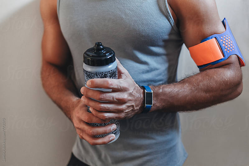 Sporty Man Holding a Water Bottle by Lumina for Stocksy United