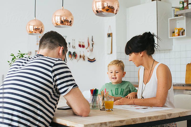 Family of Three at Home - Caucasian Parents Painting With Small Blond Boy at Kitchen Table by Julien L. Balmer for Stocksy United