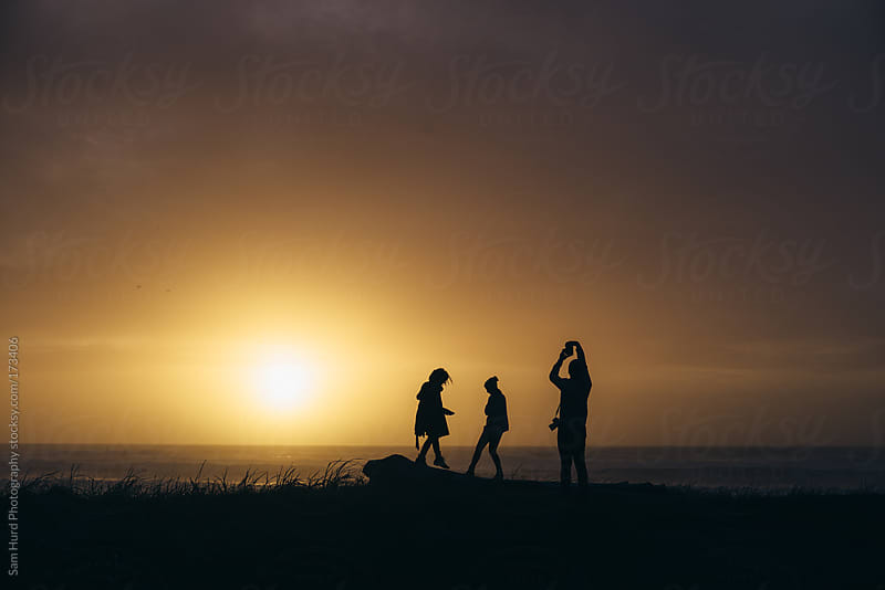 friends and california sunsets by Sam Hurd Photography for Stocksy United