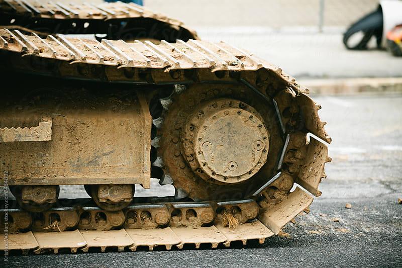 Muddy Caterpillar Wheel of an Excavator by Kristine Weilert for Stocksy United
