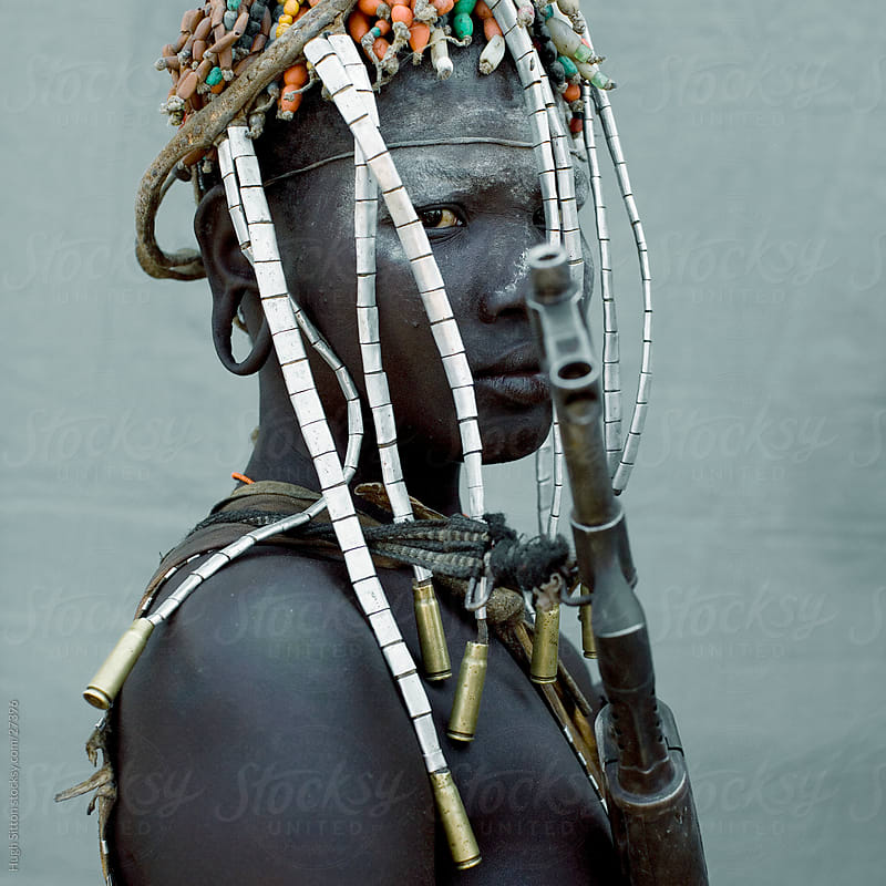 Mursi tribal woman adorned. Ethiopia by Hugh Sitton for Stocksy United