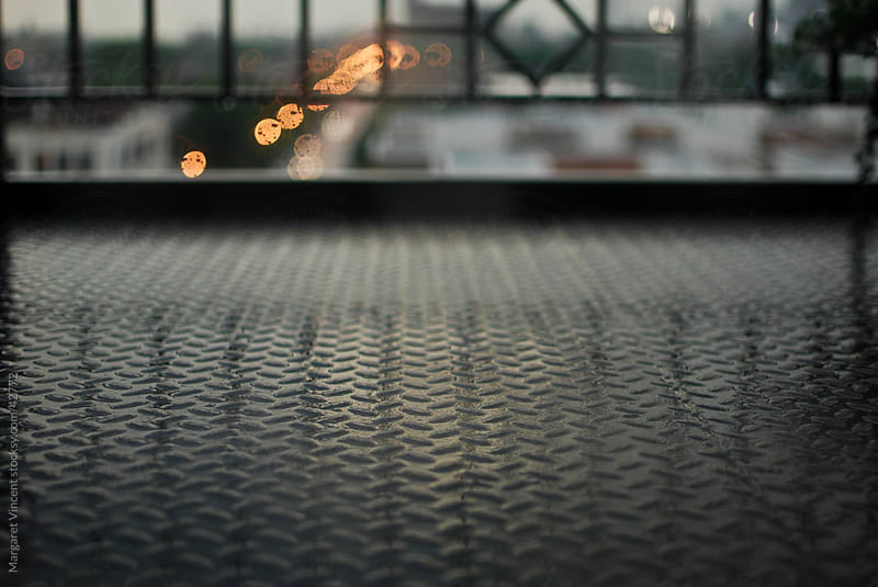 industrial urban  balcony after the rain by Margaret Vincent for Stocksy United