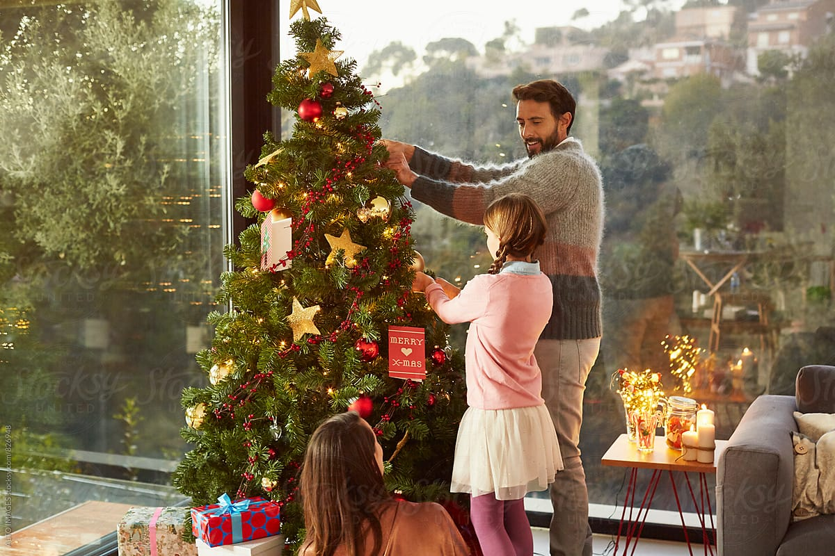 At Home Christmas Trees.Happy Family Decorating Christmas Tree At Home By Alto