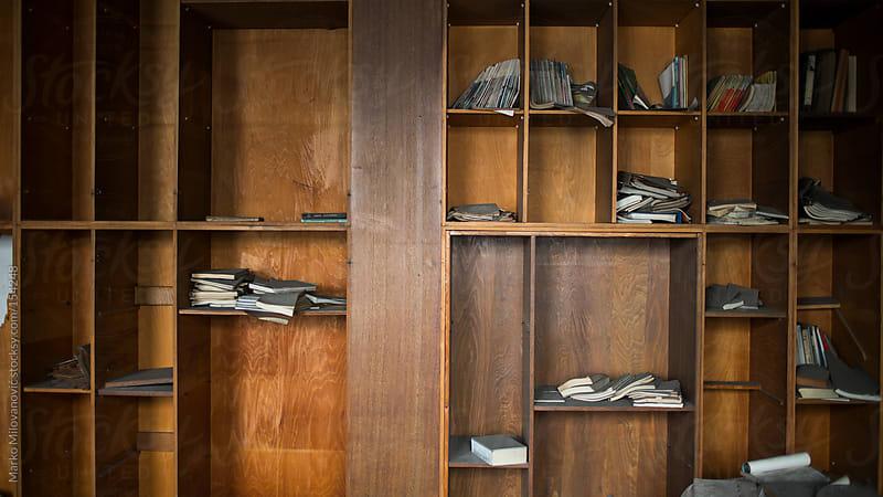 Books on shelf, not in line by Marko Milovanović for Stocksy United