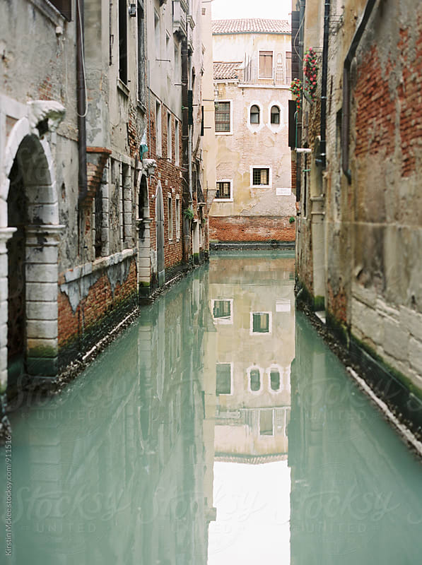Reflections in a canal in Venice by Kirstin Mckee for Stocksy United