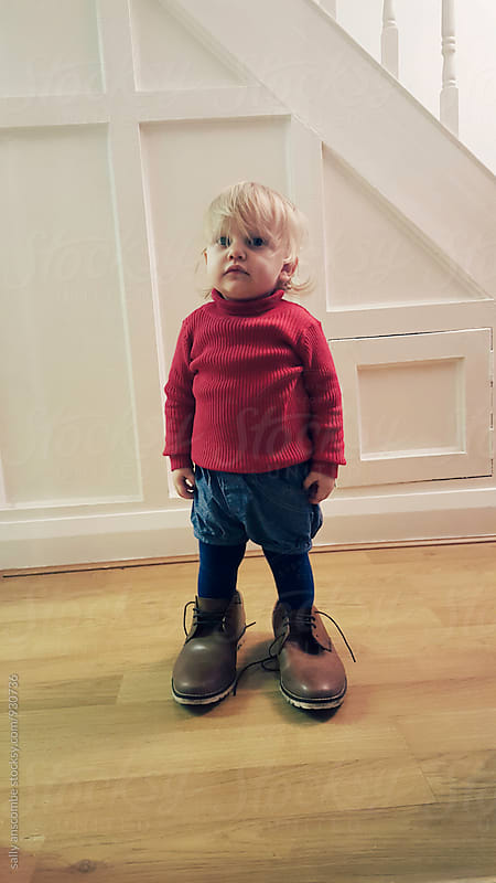 Child wearing her Fathers shoes by sally anscombe for Stocksy United