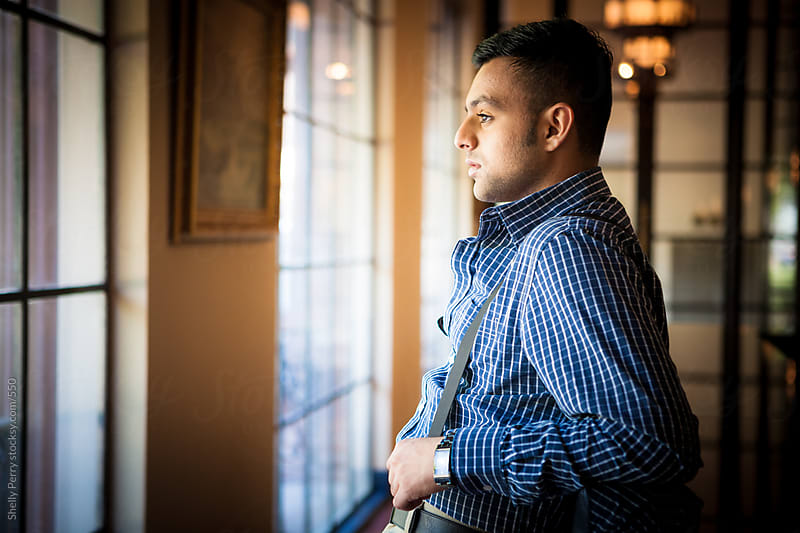 Portrait series of a young man of south asian heritage  by Shelly Perry for Stocksy United