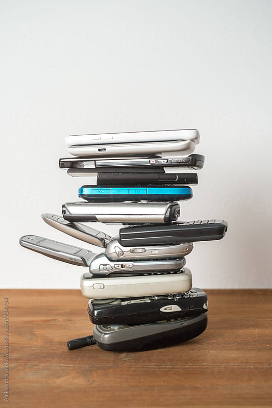 Stacked Used Mobile Phones  by Aleksandra Jankovic for Stocksy United