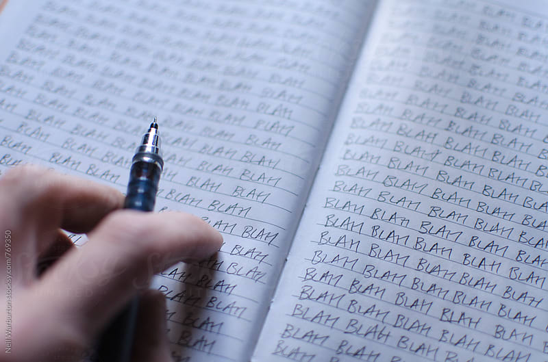 Notepad and hand of a bored person by Neil Warburton for Stocksy United