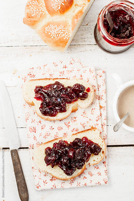 Breakfast challah with cranberry jam and coffee by Babett Lupaneszku for Stocksy United