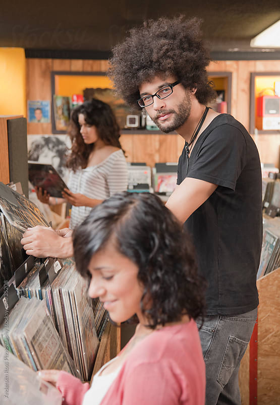Young people browsing records at record shop by Andersen Ross Photography for Stocksy United
