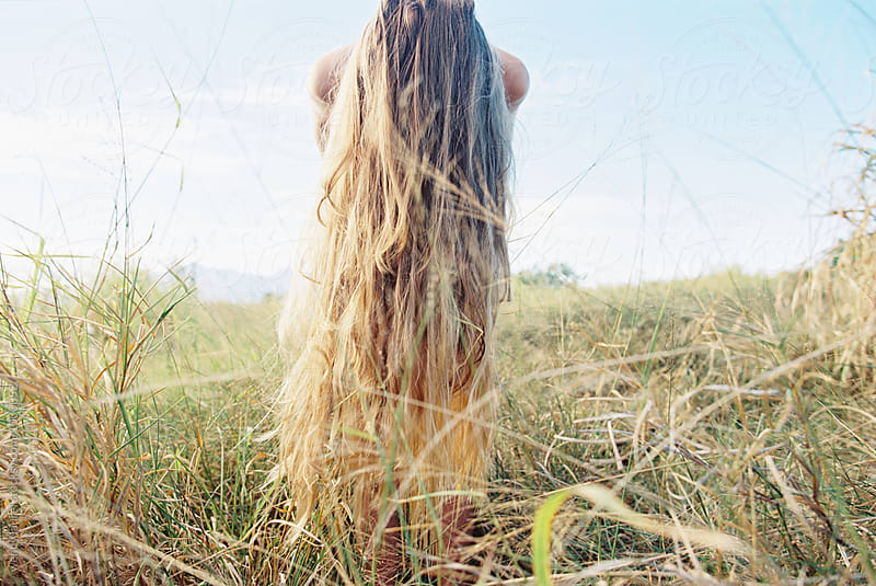 long blonde hair in sunlight in field by wendy laurel for Stocksy United