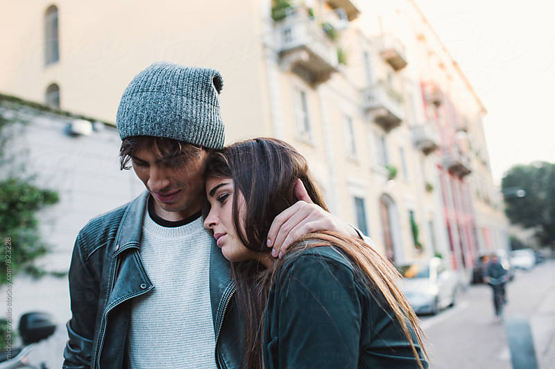 Young couple in the street by michela ravasio for Stocksy United