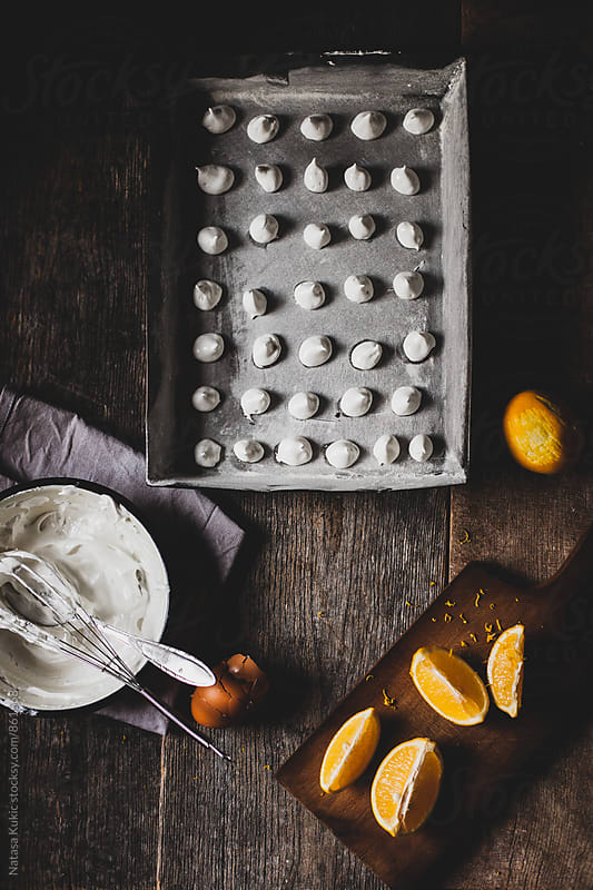 Meringues in a pan ready for baking by Natasa Kukic for Stocksy United