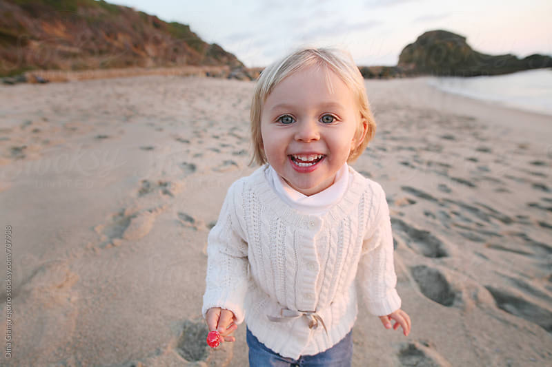 Wide Angle View On Little Blonde Girl On Beach by Dina Giangregorio for Stocksy United