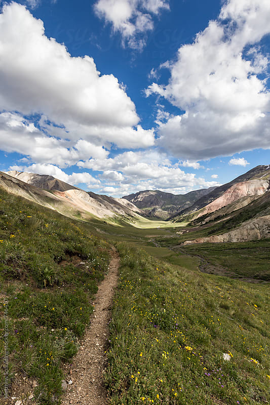 Hiking trail in mountain valley during summer by Matthew Spaulding for Stocksy United