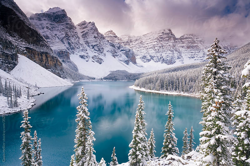 Wenkchemna Peaks or Ten Peaks rising over Moraine lake in the snow, near Lake Louise, Banff National Park, Alberta, Canada, North America by Gavin Hellier for Stocksy United