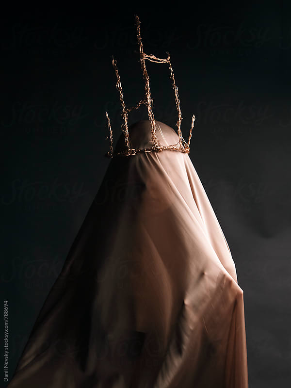 Woman under beige veil with crown made of gold wire by Danil Nevsky for Stocksy United