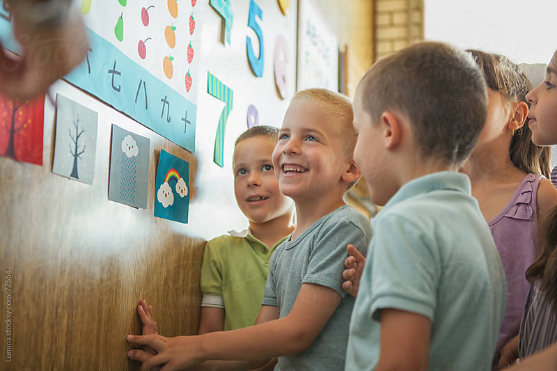 Smiling Schoolchildren by Lumina for Stocksy United