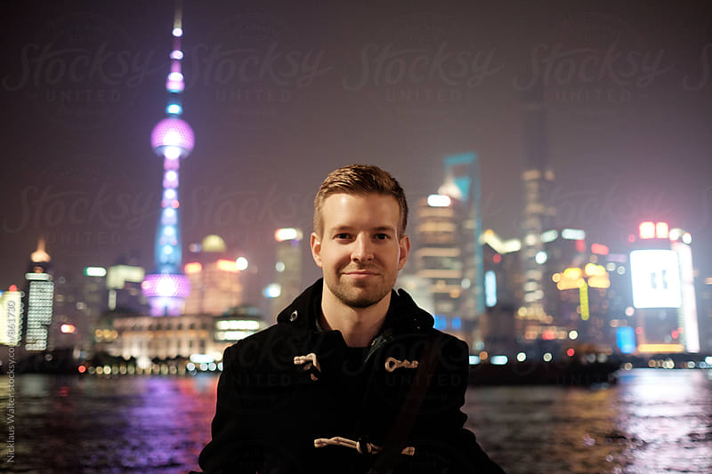 Man in Shanghai at Night by Nick Walter for Stocksy United