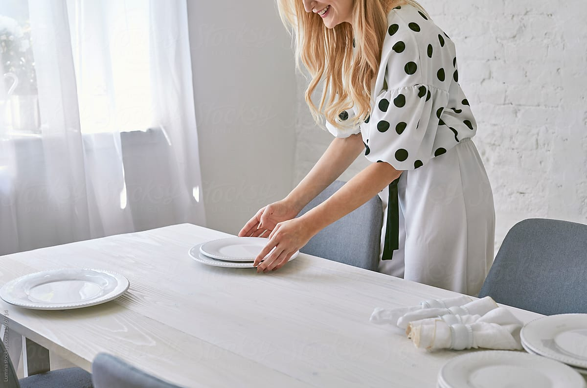 Woman Setting Up Table By Lumina Dinner Set