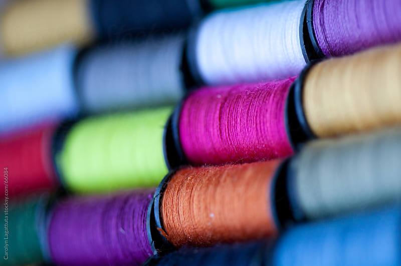 Several spools of colorful thread by Carolyn Lagattuta for Stocksy United