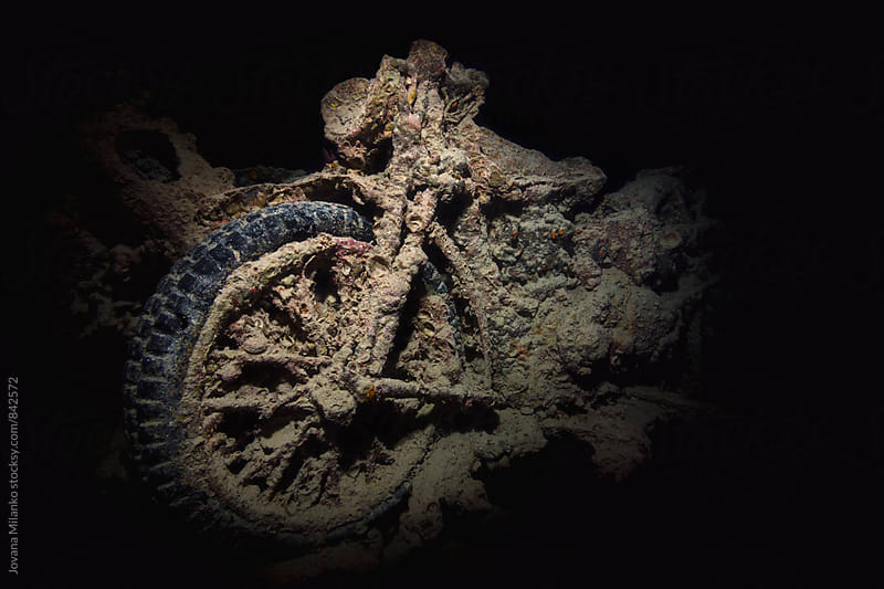 Motorbike underwater inside of a SS Thistlegorm shipwreck in Suez Canal   by Jovana Milanko for Stocksy United