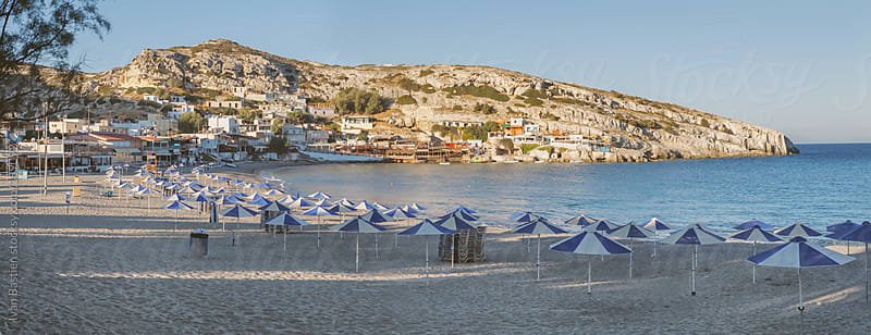 Empty Matala beach at sunrise in Crete, Greece by Ivan Bastien for Stocksy United