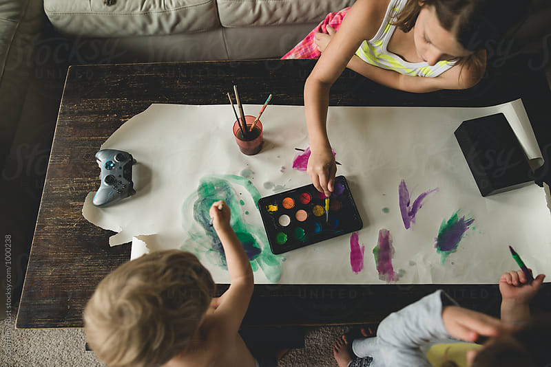 Bird's Eye Homeschool craft/paint time by Courtney Rust for Stocksy United