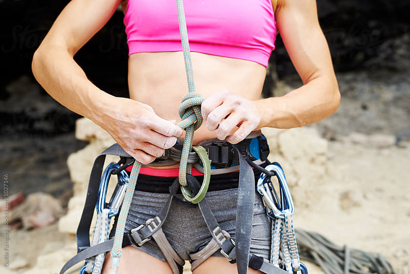 Close-up of athletic sportswoman putting on climbing gear by Guille Faingold for Stocksy United