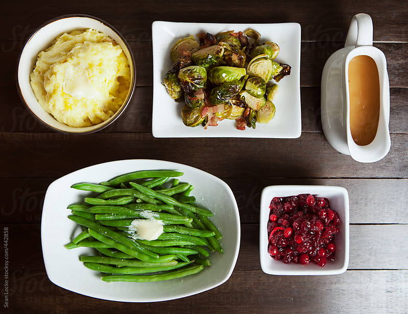 Thanksgiving: Variety Of Holiday Side Dishes On Table by Sean Locke for Stocksy United