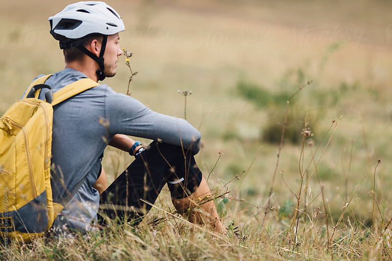 Cyclist Takes a Rest in Nature by Lumina for Stocksy United