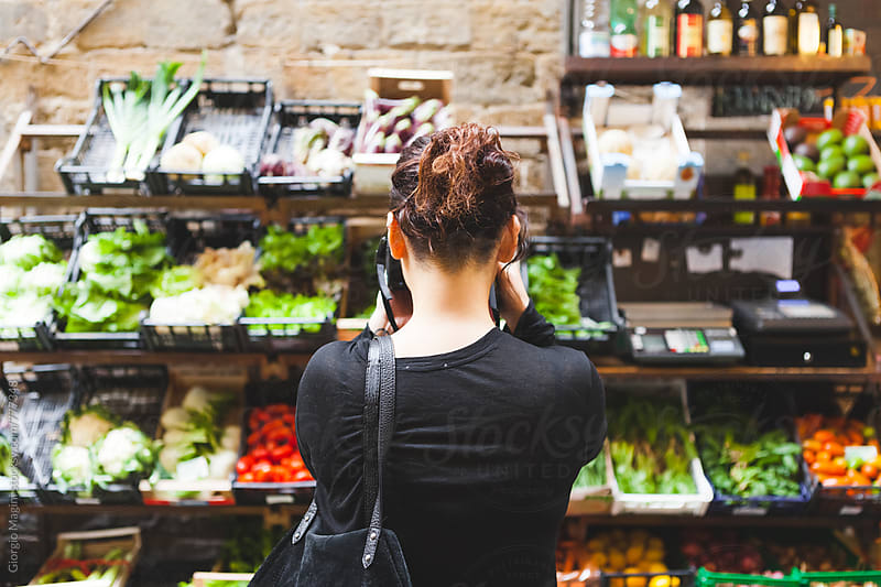 Young Woman Photographing Vegetables and Fruits Shop Outdoors in Italy by Giorgio Magini for Stocksy United