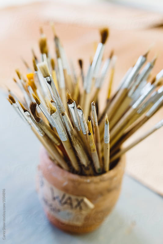 Collection of paint brushes in pot by Carey Shaw for Stocksy United