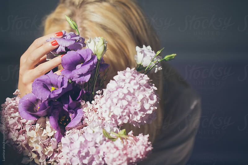 Woman Holding a Lilac Bouquet by Lumina for Stocksy United