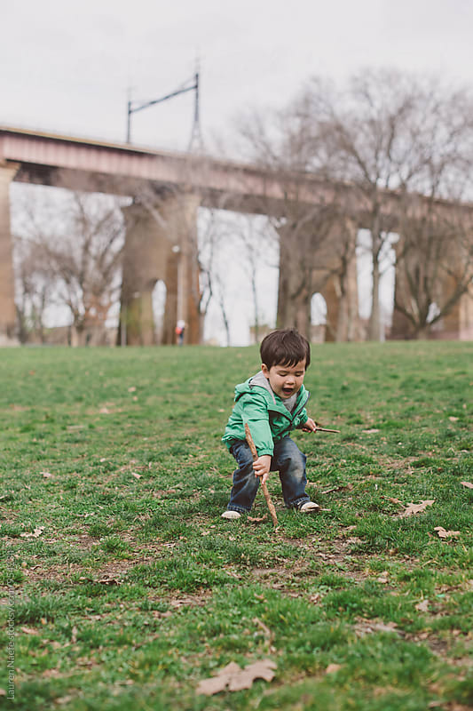 Little kid playing in the park by Lauren Naefe for Stocksy United